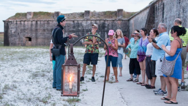 A tour guide leads the Candlelight Program through Fort Pickens on July 22, 2016.