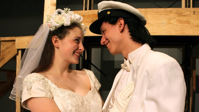 """The bride-to-be Julia (Elise Cumbia) looks into the eyes of groom-to-be Robbie (Michael Bentea Kelly) during their wedding after Robbie had been left altar previously in """"The Wedding Singer,"""" which concludes a two-weekend run the show at Hardin-Simmons University from Friday through Sunday.  """