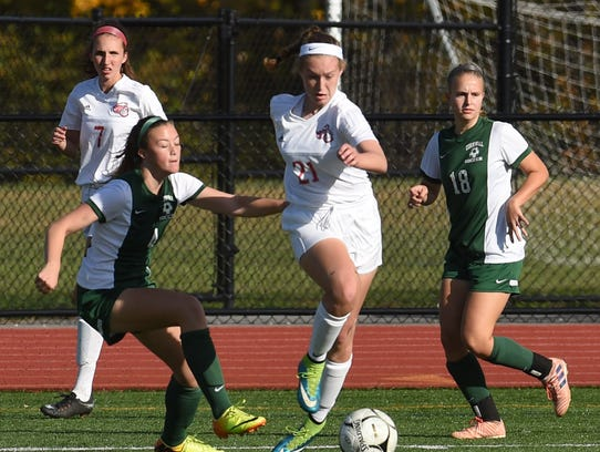 Red Hook's Casey Shein, center, tries to keep control