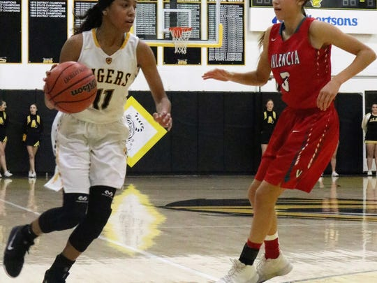 Alamogordo's Justyse Martin, left, tries to dribble