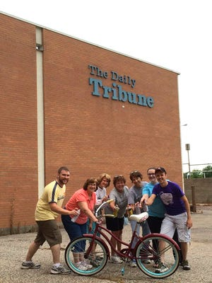 Members of Sunrise Rotary help with the River Riders Bike Share program.