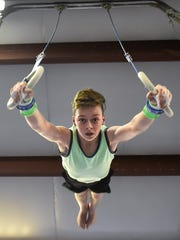 Grant Middle School's Brody McDonald works out on the rings at Mid Ohio Gymnastics on Thursday. The 13-year-old will compete at nationals in Michigan during the first weekend in May.