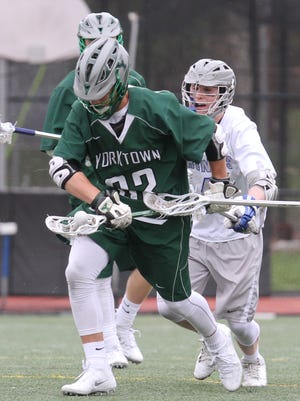 Yorktown's Anthony Altimari (33) gains control of the ball over Bronxville defense during boys lacrosse at Bronxville High School on April 7, 2016. Yorktown defeats Bronxville 9-5.