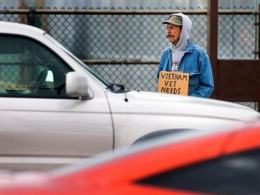 PNI cr panhandlers at freeway exits