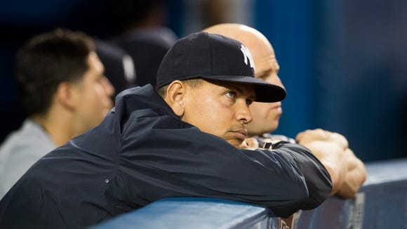 New York Yankees' Alex Rodriguez watches from the dugout during the inning of a baseball game against the Toronto Blue Jays on Tuesday, May 31, 2016, in Toronto. Toronto won 4-1.