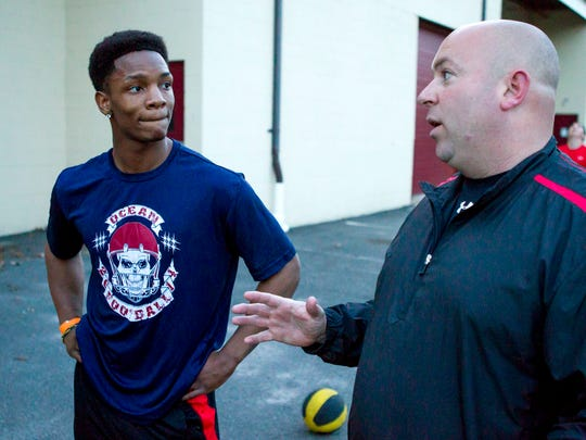 Ocean Township junior running back Tyler Thompson, 17, with Spartans coach Don Klein during a workout at JM Power U., in Eatontown.