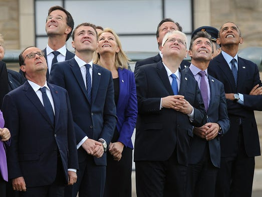 World leaders watch as the British Royal Air Force Red Arrows aerobatic team perform on Sept. 5 at t he NATO summit in Newport, England.