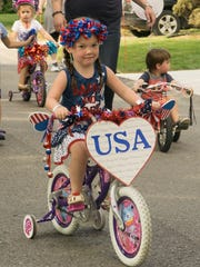 Four-year-old Adeline Talmadge rides in the parade.