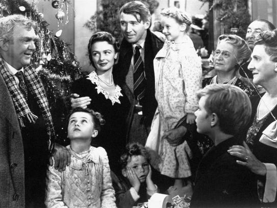 James Stewart as George Bailey, center, is reunited