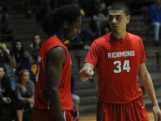 Daric Clemens of Richmond (34) greets teammate Tyrone