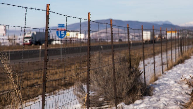 A tall fence lines I-15 at the north end of Cedar City, Thursday, Feb. 11, 2016.