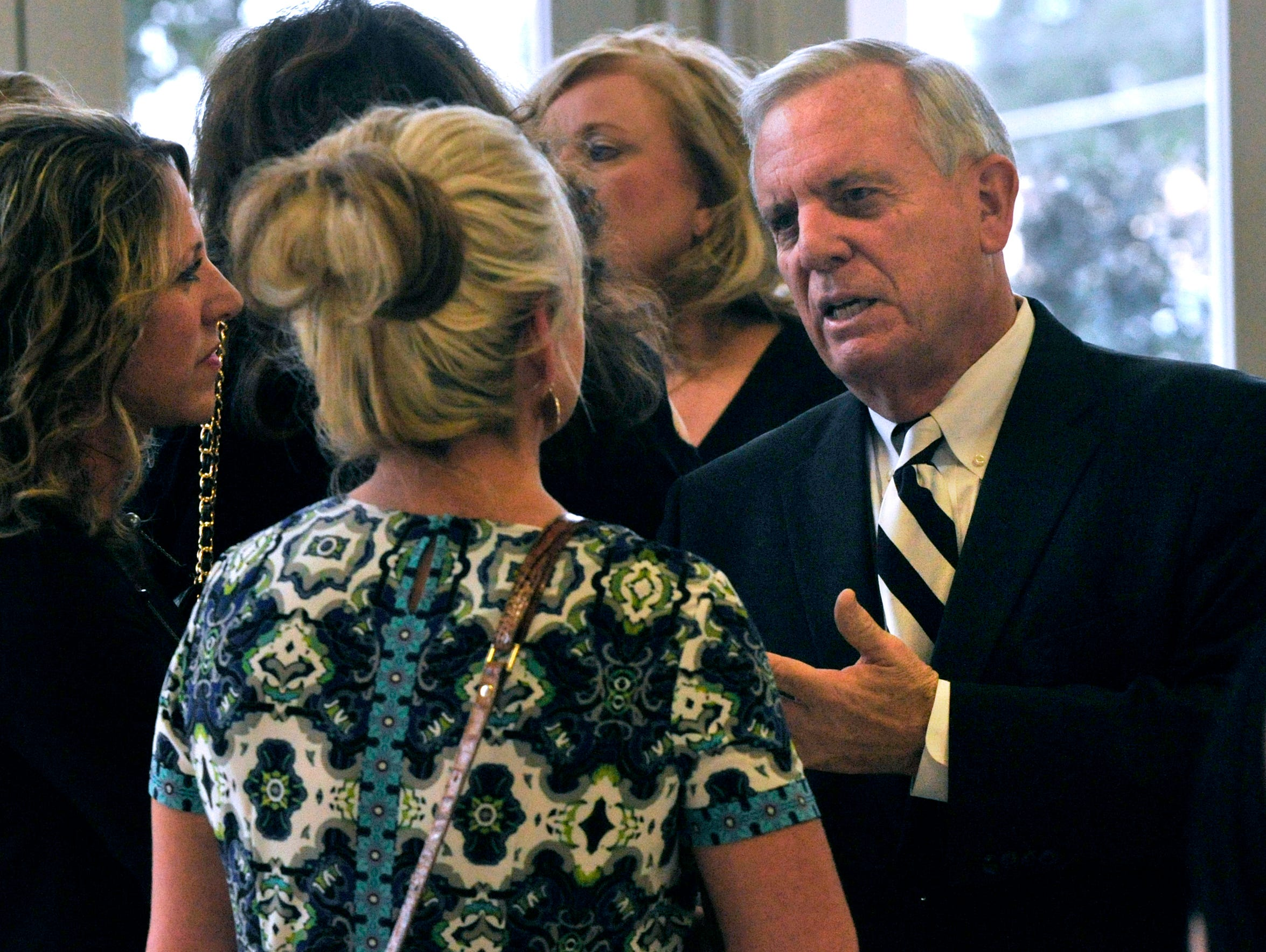 Former Abilene Mayor Norm Archibald speaks to other attendees Thursday evening at the Abilene Convention Center. Archibald later was named as the 2017 Outstanding Citizen of the Year by the Abilene Chamber of Commerce at its annual banquet.
