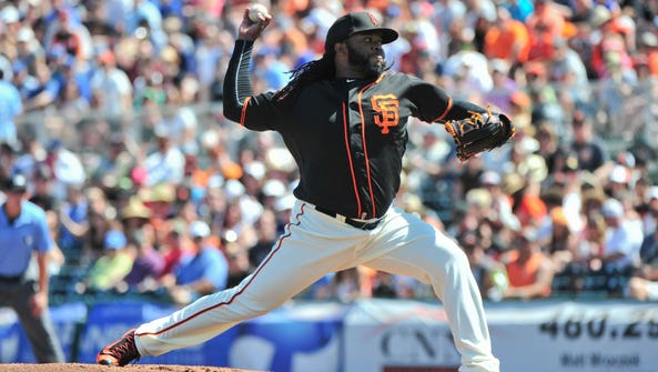 San Francisco starting pitcher Johnny Cueto (47) throws