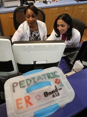 Dr. Vinita Pitchumoni, a pediatric emergency physician at CentraState Medical Center, speaks with (left) Dr. Florence Ibale, a pediatric emergency physician, in the pediatric emergency department at CentraState Medical Center in Freehold.