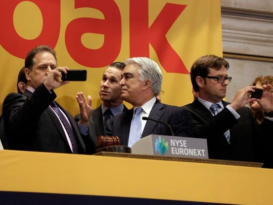 Kodak CEO Antonio Perez, center, talks with NYSE Executive Vice President Scott Cutler, second left, before opening bell ceremonies of the New York Stock Exchange earlier this year.