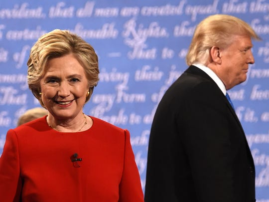 Hillary Clinton and Donald Trump leave the stage after the first presidential debate at Hofstra University in Hempstead, N.Y., on Sept. 26, 2016.