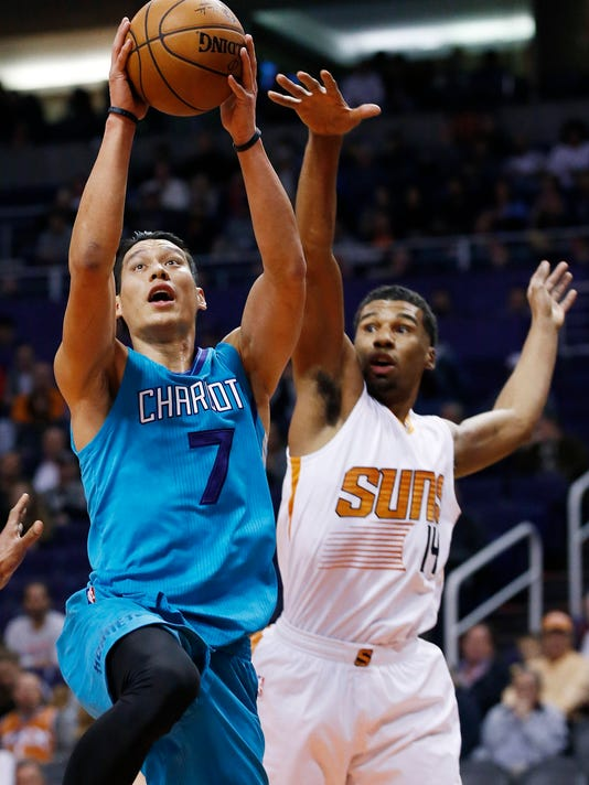 Charlotte Hornets' Jeremy Lin (7) drives past Phoenix Suns' Ronnie Price, right, during the first half of an NBA basketball game Wednesday, Jan. 6, 2016, in Phoenix. (AP Photo/Ross D. Franklin)