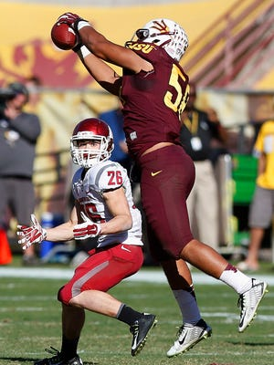 Arizona State's Salamo Fiso intercepts a pass intended for Washington State's Tyler Baker during the second half on Saturday, Nov. 22, 2014, in Tempe.
