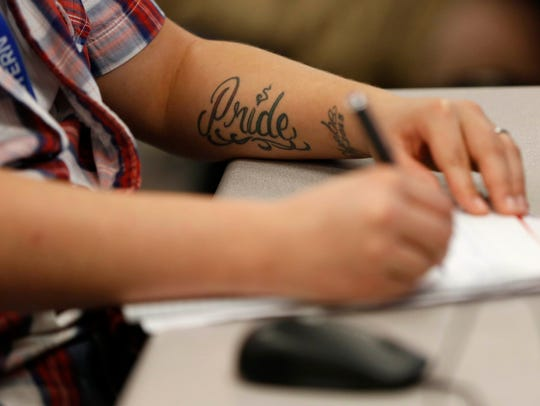 Mikey Fletcher of Omaha, Neb., takes notes in his accounting
