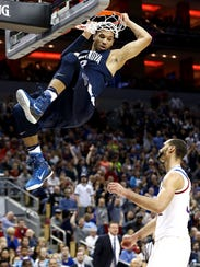 Villanova Wildcats guard Josh Hart (3) dunks the ball