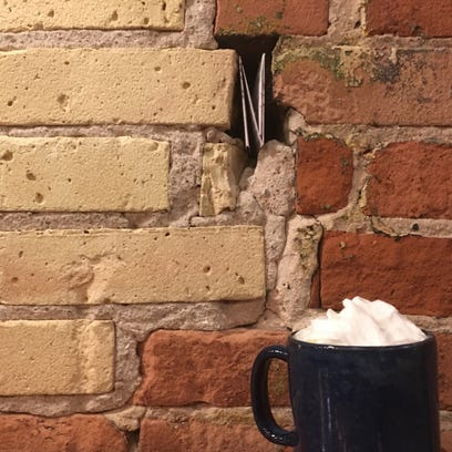 Hidden note in coffeehouse restores reporter's faith in humanity