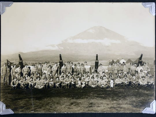 Emile John and his platoon with Mount Fuji as a backdrop.