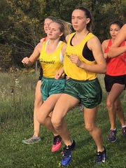Howell returns Alyssas Kanclerz (left) and Emily Endebrock