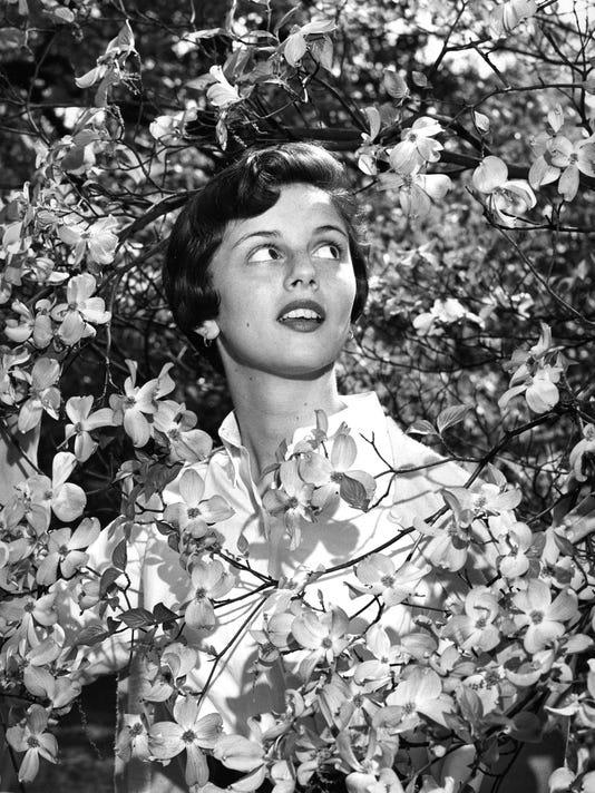 Myra-Wolfe-and-dogwood-1957-by-June-Glenn.jpg