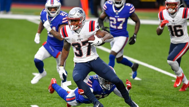 New England Patriots running back Damien Harris (37) breaks a tackle by Buffalo Bills' Dean Marlowe (31) during the second half of an NFL football game Sunday, Nov. 1, 2020, in Orchard Park, N.Y. Harris went on to score a touchdown on the play.