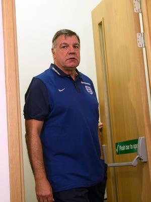 Sam Allardyce was shown the door Tuesday as coach of England's national team.