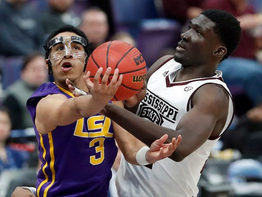 LSU's Tremont Waters (3) shoots as Mississippi State's Abdul Ado defends during the second half in an NCAA college basketball game at the Southeastern Conference tournament Thursday, March 8, 2018, in St. Louis.(AP Photo/Jeff Roberson)