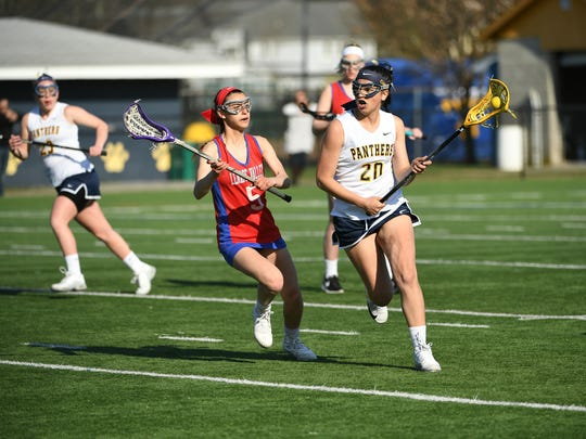 Pequannock senior Samantha Cherenson (20) carries the ball up the field in a game against Lenape Valley.