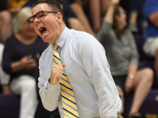 Moeller  head coach Matt  McLaughlin reacts during  the Cruaders  volleyball state semi-final game against Beavercreek  Sunday, June 3. 2018.
