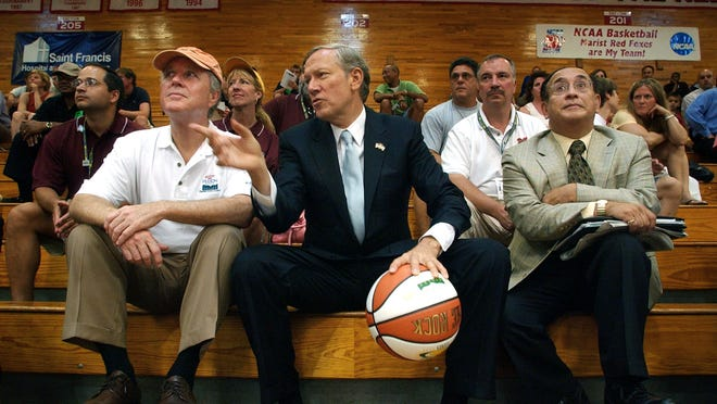 Then-Gov. George Pataki, gesturing, at a basketball game at Marist College in 2005.