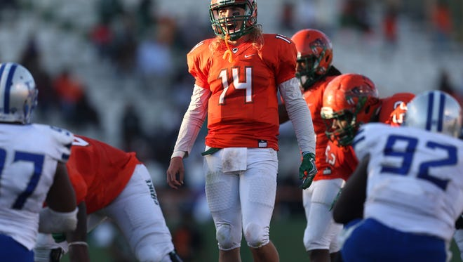 FAMU's Ryan Stanley yells out to his team before snapping the ball during their game against Hampton on Homecoming earlier this season at Bragg Memorial Stadium.
