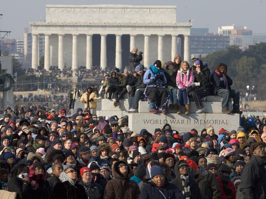 Crowds watch the inauguration on the National Mall