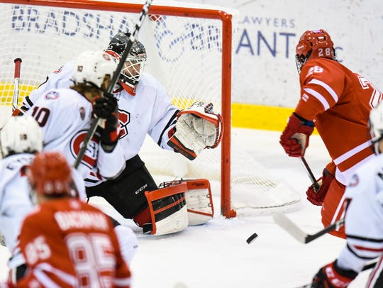 St. Cloud State's Jeff Smith, 1, blocks a shot by Miami
