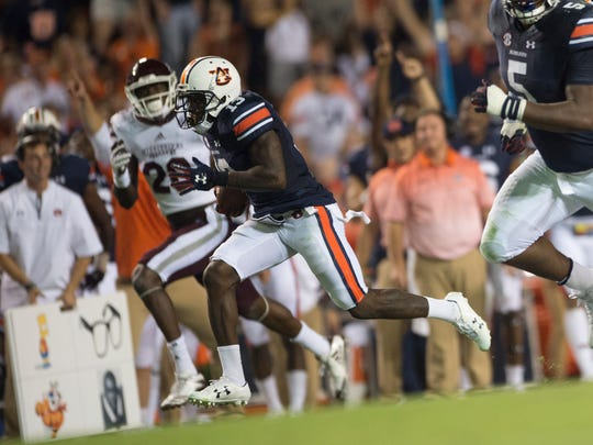 Auburn defensive back Javaris Davis (13) returns an