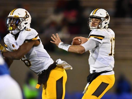 Wyoming Cowboys quarterback Josh Allen (17) prepares