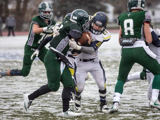Algonac's Dylan Jack makes a tackle during a Division