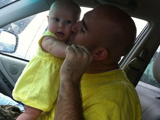 Casey Moore with daughter, Lucy.