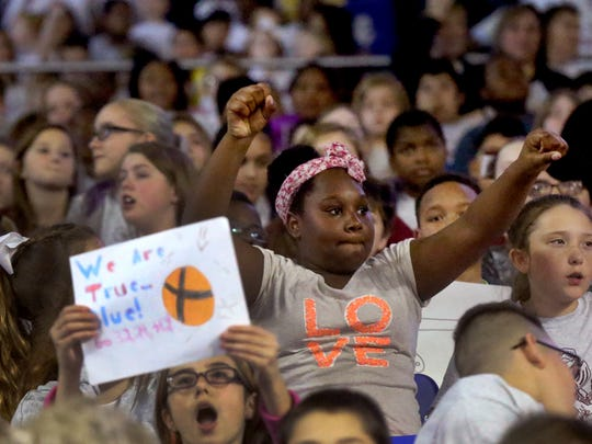 Destiny Madison, a fifth-grader from Northfield Elementary cheers on the Lady Raiders during the Education Day game Thursday. The crowd was the largest of the season with an attendance of 11,141.