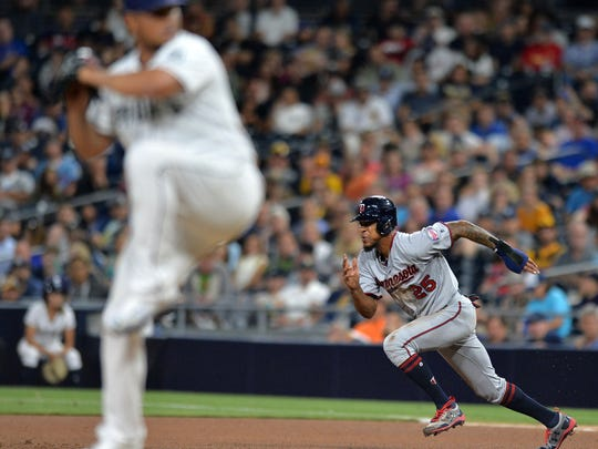 Aug 1, 2017; San Diego, CA, USA; Minnesota Twins center fielder Byron Buxton (25) steals second as San Diego Padres starting pitcher Jhoulys Chacin (foreground) pitches during the seventh inning at Petco Park. Mandatory Credit: Jake Roth-USA TODAY Sports