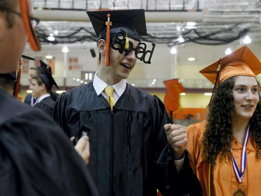 "Central York senior Kyle Godfrey sports ""grad"" glasses while waiting in the gym before commencement on Friday at Central York."