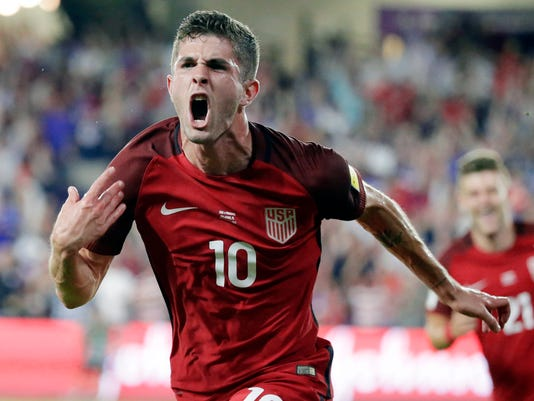 FILE - In this Oct. 6, 2017, file photo, United States' Christian Pulisic (10) celebrates his goal against Panama during the first half of a World Cup qualifying soccer match in Orlando, Fla. Nineteen-year-old Christian Pulisic has become the youngest winner of the U.S. Soccer Federation's Male Player of the Year award, USSF said Thursday, Dec. 14, 2017. (AP Photo/John Raoux, File)