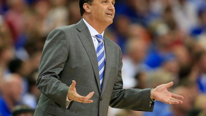 John Calipari and the eighth-seeded Wildcats in blue weren't thrilled with their slotting.
