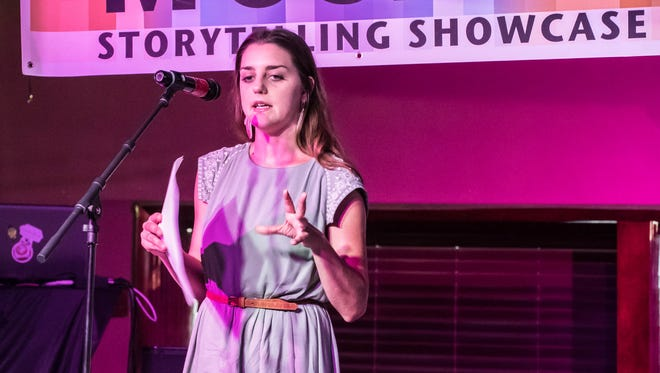 Ruth Wolverton speaks during the Mosaic Story Telling Showcase at the Warehouse on Thursday evening.