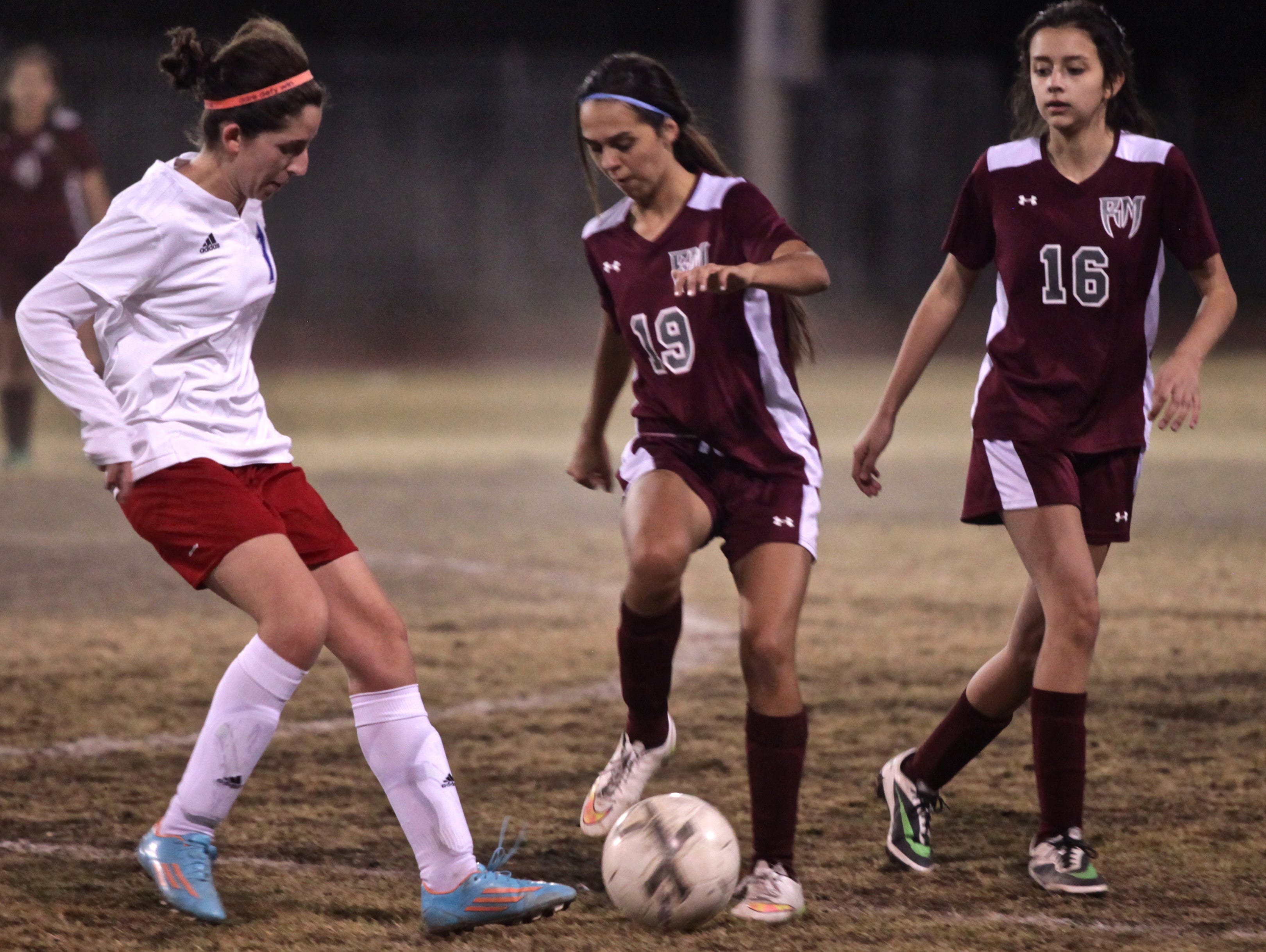 Rajahs' Galilea Cortez (16) and Rattlers' Fernanda Mercado (19) dispute the ball during a match between the teams in Indio on Tuesday.
