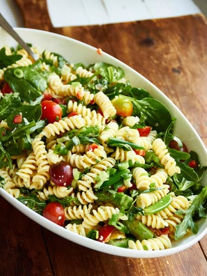 In this simple vegetarian spring pasta salad, the asparagus and sugar snap peas get a bit more tender and keep their bright green color after a quick simmer, and the best part is that you can add them right into the pasta at the end of the cooking time.