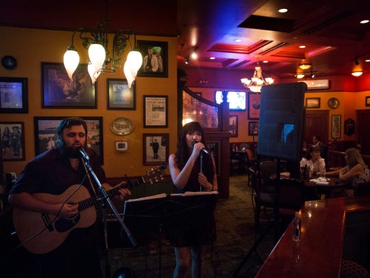 James Badger and Sarah Rose, who make up the indie duo Badger & Rose, perform at The Pub in North Naples on Thursday, Sept. 28, 2017.